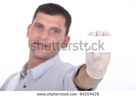 man holding out blank business card - stock photo