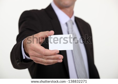 Man holding out business card - stock photo