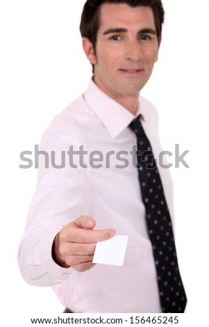Man holding out his business card - stock photo