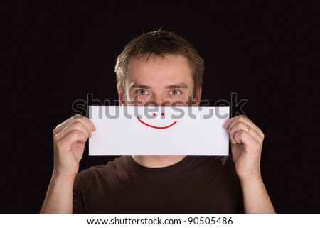 Man holding paper with a drawn smile