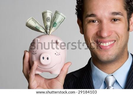Man Holding Piggy Bank - stock photo