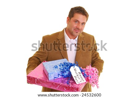 "Man holding presents with a tag saying ""Happy Mother's Day"" in a brown suit coat isolated against white"