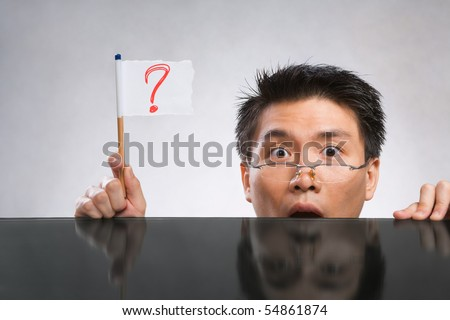 Man holding question mark flag made of paper and pencil - stock photo