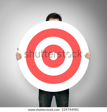 man holding red darts target - stock photo