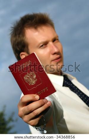 man holding russian passport - stock photo