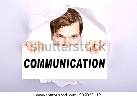 man holding sign with the word communication - torn ripped paper background