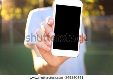 Man holding smartphone - stock photo