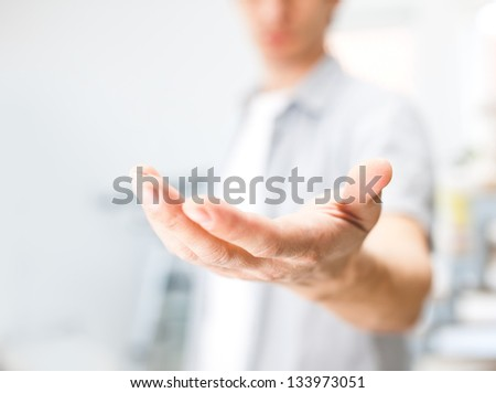 Man holding something on his hand - stock photo