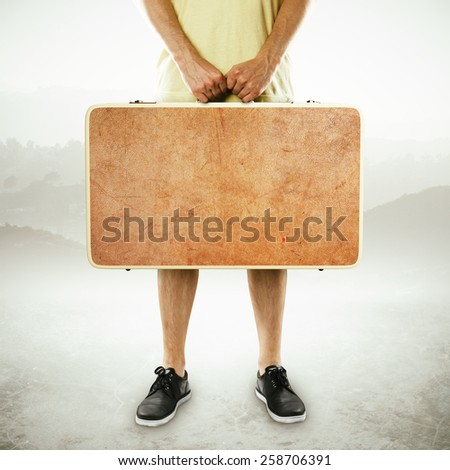 man holding suitcase on a white background - stock photo