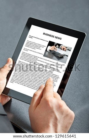 man holding tablet computer with business text on the screen - stock photo