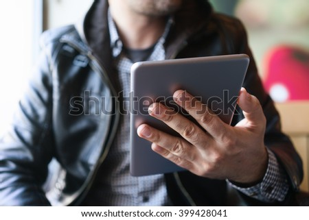 man holding tablet pc - stock photo