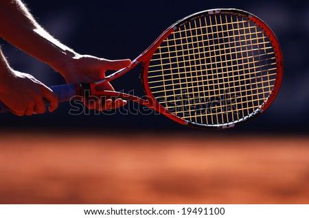 Man holding tennis racket - stock photo
