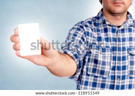 Man holding the blank white card - stock photo