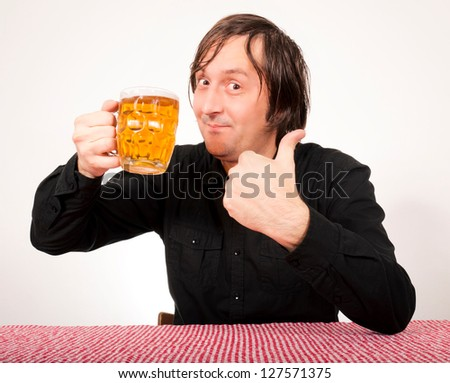 Man holding the pint of beer and showing ok sign - stock photo