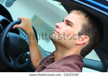 Man holding the Steering Wheel