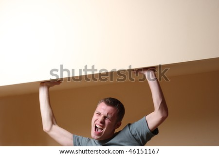 Man holding the wall with copyspace - stock photo