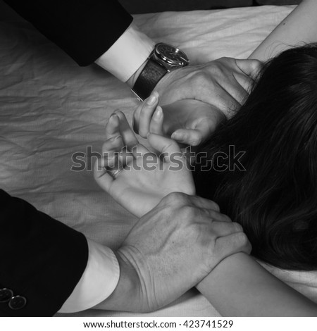 man holding the woman`s hand. Boudoir type photo