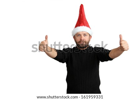 man holding thumbs up for Christmas isolated on white background - stock photo