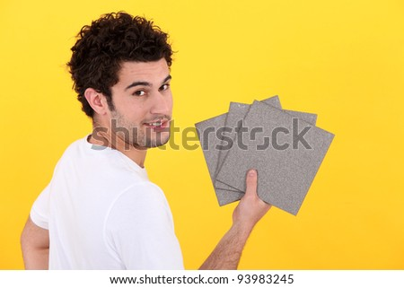 Man holding tiles - stock photo
