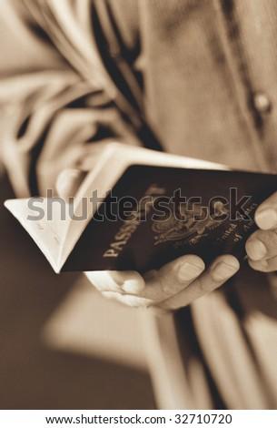 Man Holding United States Passport - stock photo