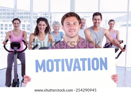 Man holding up a sign against motivation - stock photo