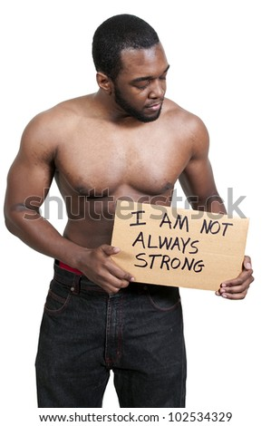 Man holding up a sign that says I am not always strong - stock photo