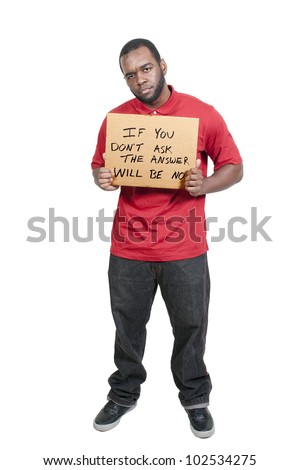 Man holding up a sign that says If You Don't Ask The Answer Will Be No