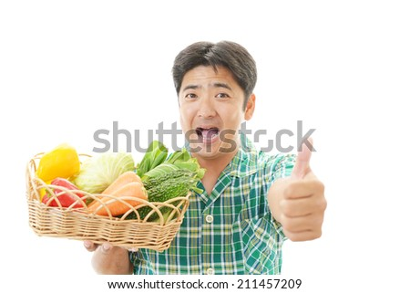 Man holding vegetables. - stock photo