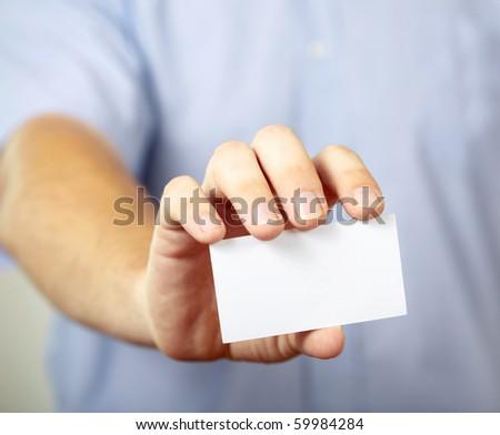 Man holding visiting card - stock photo