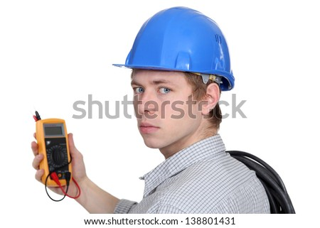 Man holding volt meter - stock photo