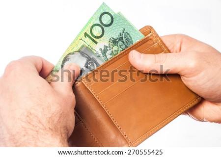 Man holding wallet with Australian money - stock photo
