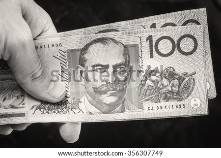 Man holding wallet with Australian money