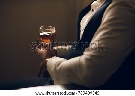 Man holding whiskey glass in hands