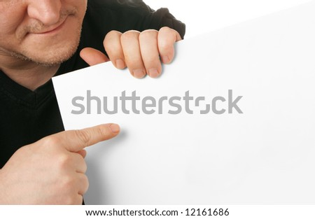 Man holding white blank cardboard, put your own text here - stock photo