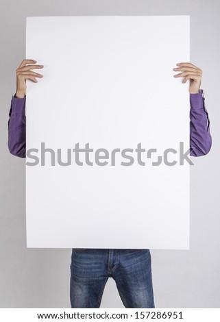 man holding white blank poster - stock photo
