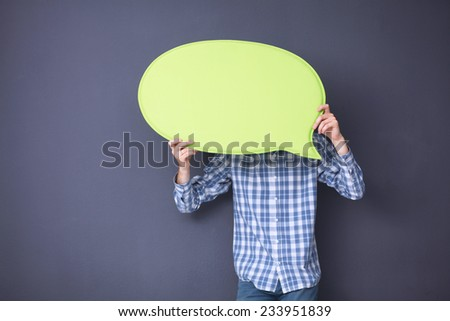Man holding white blank speech bubble with space for text, isolated - stock photo