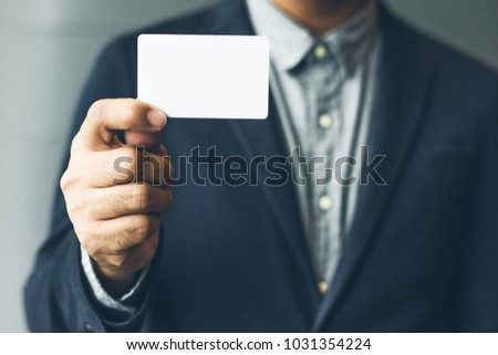 Man holding white business card man wearing stock photo royalty man holding white business cardman wearing blue shirt and showing blank white business card colourmoves