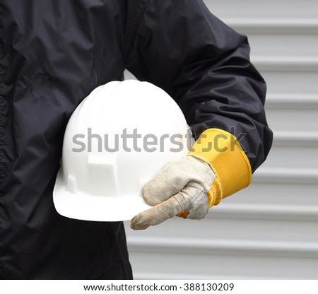 Man holding white helmet close up - stock photo