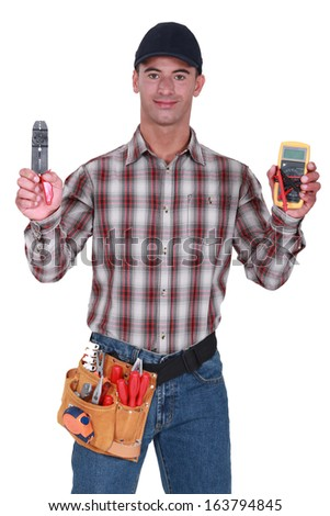 Man holding wire clipper - stock photo