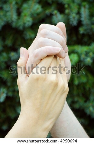 Man holding woman`s hand