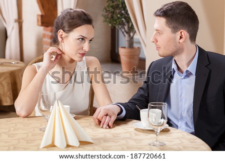 Man holding woman's hand on a dinner - stock photo