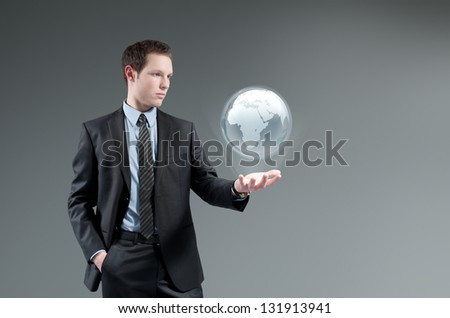 Man holding world globe Hologram. Future interface. Futuristic technology concept. Global business management. - stock photo