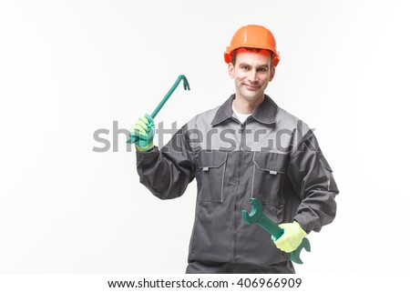 Man Holding Wrench Over White Background tool hand - stock photo