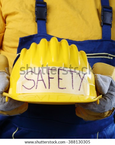 Man holding yellow helmet close up - stock photo
