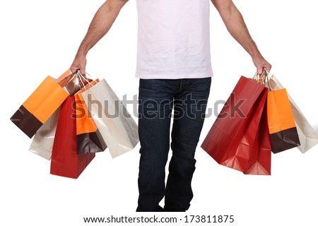 Man holdingshopping bags - stock photo