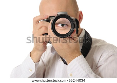man holds a big camera in his hands. Isolated on white background - stock photo
