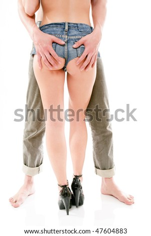 man holds a woman's buttocks isolated on white background - stock photo