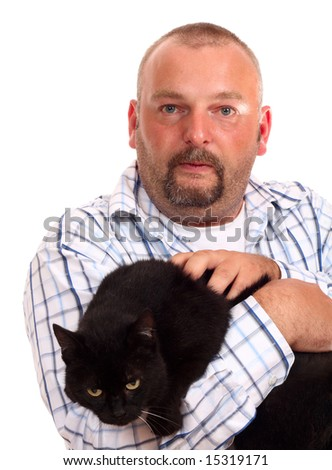 man holds black cat in hands - stock photo