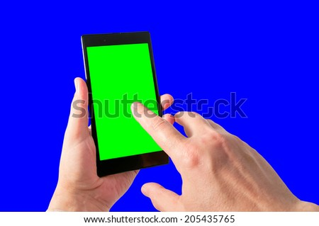Man holds in hand and taps by index finger tablet PC in portrait mode with green screen isolated on white. Chroma key screen for placement of your own content.  - stock photo