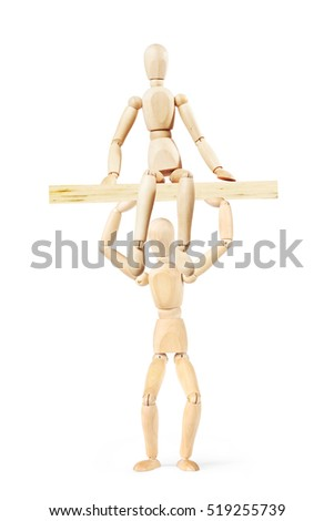 Man holds over the head a wooden board where sits another person. Abstract image with a wooden puppet